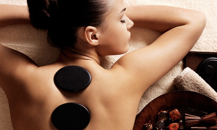 Massage 49 - Addison/Carrollton: Signature Massage with Hot Stones and Towels for One or Two at Massage 49 (Up to 56% Off)