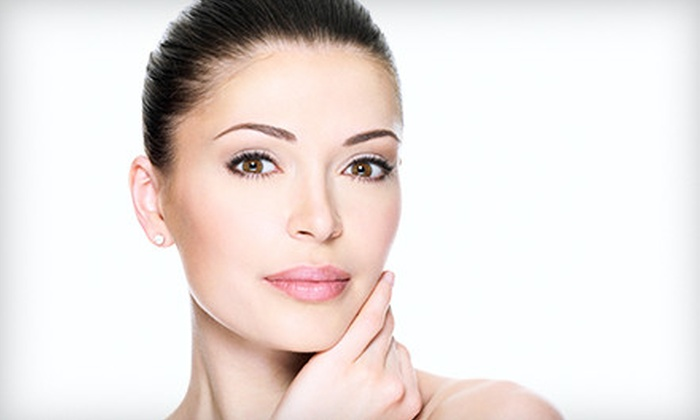 A Feel Good Experience Spa - Addison: One or Two Microcurrent and Light-Therapy Nonsurgical Face-Lifts at A Feel Good Experience Spa (Half Off)