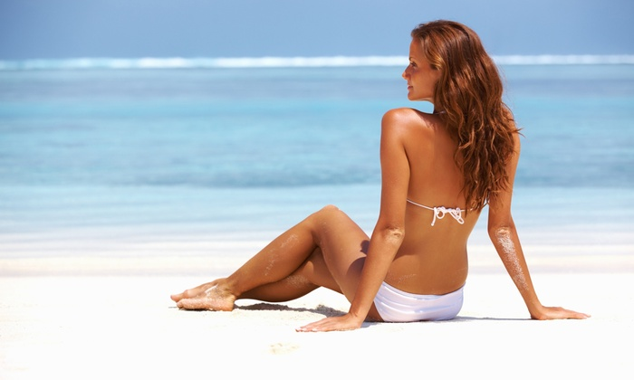 Tan United - Melrose: Month of Tanning or 2 VersaSpa Spray Tans, or 10 Tanning Sessions at Tan United (Up to 64% Off)