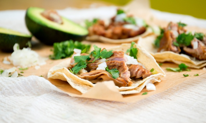 Mi Cancun  - North Raleigh: $18 for Two Groupons, Each Good for $15 Worth of Mexican Dinner Food for Two at Mi Cancun ($30 Value)