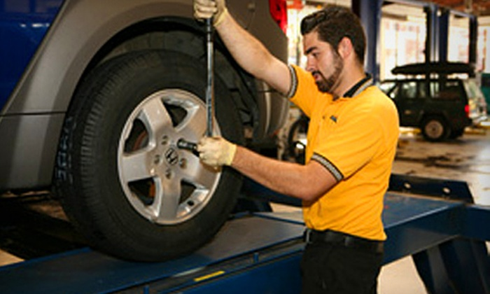 Everett Street Autoworks - Old Town - Chinatown: Four-Wheel Steering Alignment or Air Conditioning System Service at Everett Street Autoworks (Up to 51% Off)