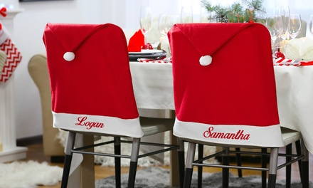 One, Two, or Four Personalized Santa Hat Chair Covers from Monogram Online (Up to 78% Off)
