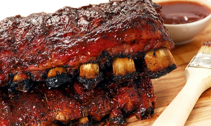 Texas Pit Bar-B-Que - Texas Pit Bar B Que: BBQ Meal for 2, BBQ Package for 12, or Holiday BBQ Package for 12 or 24 at Texas Pit Bar-B-Que (Up to 48% Off)