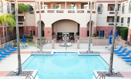 groupon daily deal - 1- or 2-Night Stay for Up to Four in a One-Bedroom Unit at Varsity Clubs of America in Tucson. Combine Up to 4 Nights.