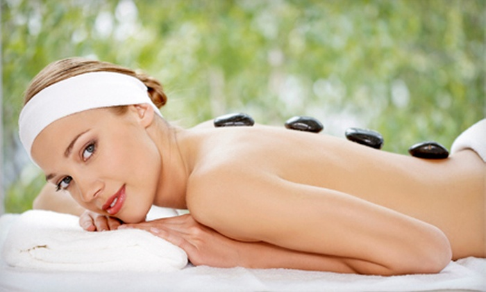 Serenity Luxury Spa - Downtown: One or Two Aromatherapy or Hot-Stone Massages or One Cranberry Body Wrap at Serenity Luxury Spa (Up to 61% Off)