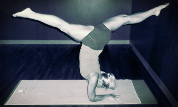 Kris' Hot Yoga - Waukee: $44 for One Month of Unlimited Hot Barre Classes at Kris' Hot Yoga ($89 Value)