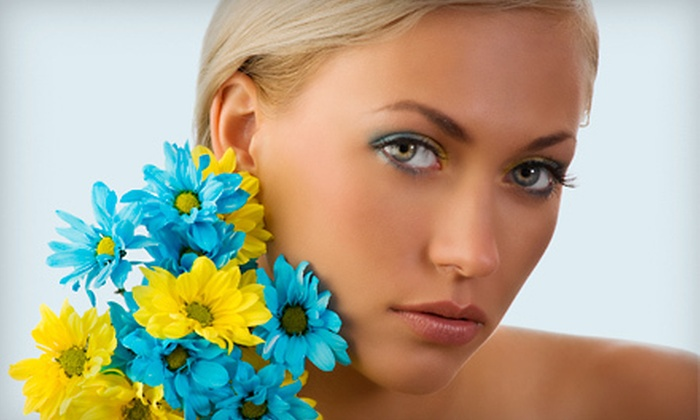 Tan-Go Tanning Salon - Miami Springs: UV and Spray Tanning at Tan-Go Tanning Salon (Up to 76% Off). Two Options Available.