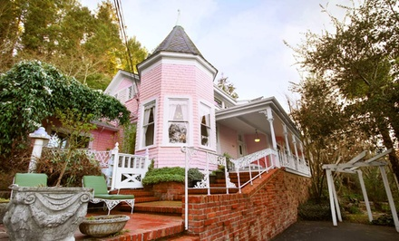 groupon daily deal - 1-Night Stay in the Garden or Forest Room, or in a Suite with a Bottle of Wine at The Pink Mansion in Calistoga, CA