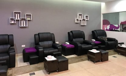 Classic or Gelish Mani-Pedi and Polish with Optional 30-Minute Foot Treatment at Tip Top Beauty Lounge (Up to 62% Off)