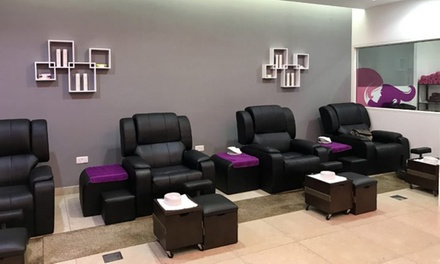 Classic or Gelish Mani Pedi and Polish with Optional 30 Minute Foot Treatment at Tip Top Beauty Lounge (Up to 62% Off)