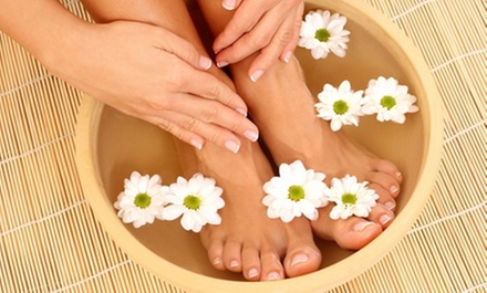 Deluxe Manicure, Deluxe Pedicure, or Deluxe Mani-Pedi with Foot Massage at Signature Nails & Spa (Up to 61% Off)