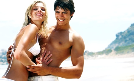 Month of Unlimited Tanning Sessions, One Airbrush Tan, or Three Norvell Spray Tans at Aruba Tan (Up to 66% Off)