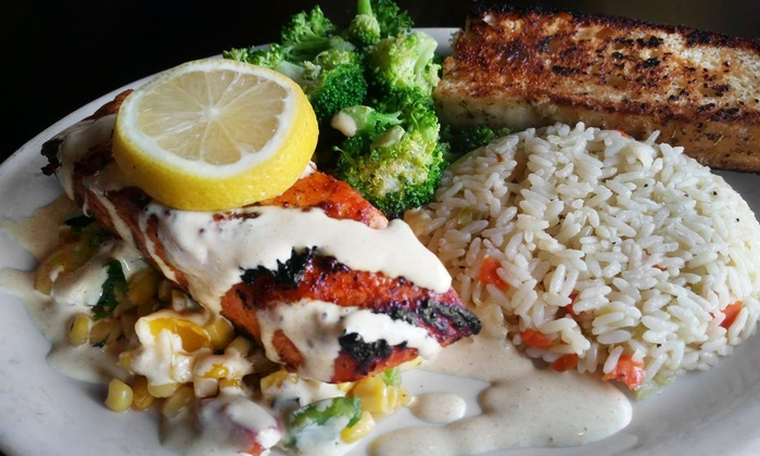 South Pacific Cafe & Lounge - Battle Ground: $12 for $20 Worth of Island-Influenced American Food