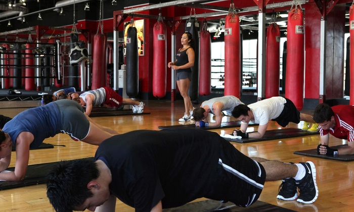 The Boxing Club - University City: One Month of Unlimited Fitness Classes or 90-Day Fitness Challenge at The Boxing Club (Up to 84% Off)