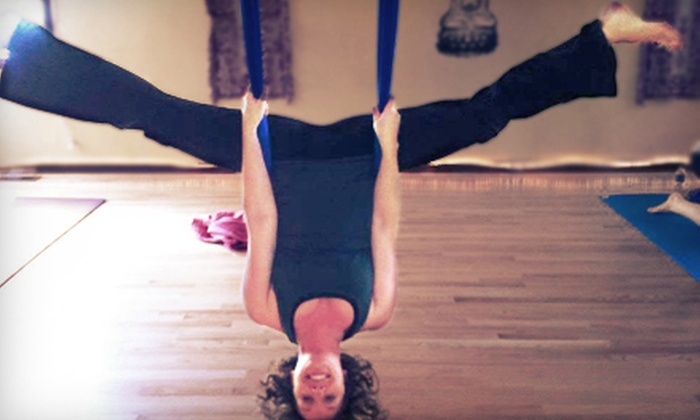 Reaching Treetops Yoga - Multiple Locations: 5 Aerial-Yoga Classes or 10 Group-Fitness Classes at Reaching Treetops Yoga (Up to 57% Off)
