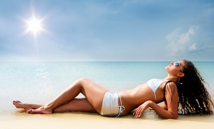 Five Drop-In Tanning Sessions or One Month of Unlimited Tanning at Basking in the Sun (Up to 58% Off)