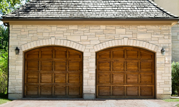 Welborn Door Company - Pioneer Crossing: $85 for a Garage-Door Tune-Up with Roller Replacement from Welborn Door Company ($179.65 Value)