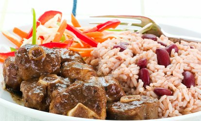 image for Jamaican Cuisine or Catering at Spices Negril <strong>Restaurant</strong> & Lounge (Up to 50% Off)