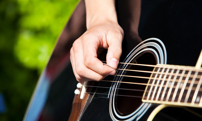 Evolution Music - Orland Park: One or Four 30-Minute Guitar Lessons at Evolution Music (Up to 67% Off)