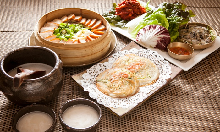 Gammeeok - Fort Lee: Korean Dinner for Two with Bossam Deluxe and Soft Tofu Hot Pot with a Pitcher of Rice Wine at Gammeeok (48% Off)