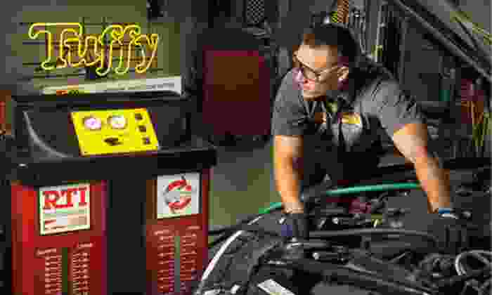 Tuffy Fort Mill - Van Wyck: Restoration of Two Headlights or Oil Change with Tire Rotation at Tuffy Fort Mill (Up to 60% Off)