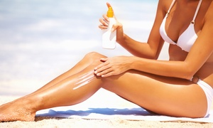 Hott Mess Tanning Salon & More: Four Airbrush Tanning Sessions at Hottmess tanning spa (44% Off)