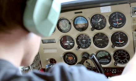 One Hour of Flight-Simulator Time or Pilot-Lesson Package at American Flyers (Up to 58% Off)