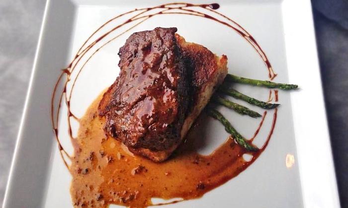 Black Cat Bistro - East Lansing: Bistro Fare for Lunch or Dinner at Black Cat Bistro (Up to 42% Off)