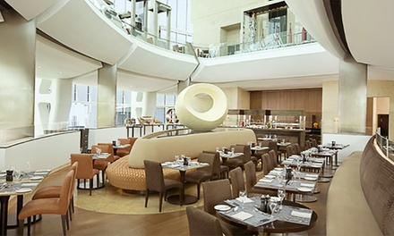 Lunch or Dinner Buffet with Drinks for Up to Four at Oceana Restaurant at 5* Hilton Capital Grand Hotel (Up to 67% Off)