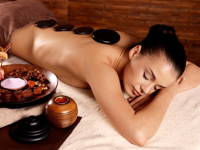 One or Three 60-Minute Hot-Stone or Swedish Massages at Frost Cosmetics & Spa (Up to 67% Off)