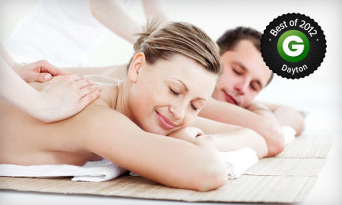 The Oasis Salon & Spa - The Delscamp Loft Condominiums: $99 for a Couples Massage with a Hand-and-Foot Treatment, Lunch, and Chocolates at The Oasis Salon & Spa ($215 Value)