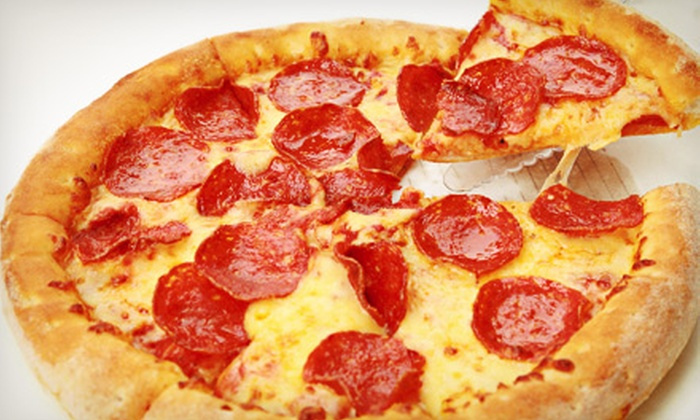 The Oasis Restaurant & Delivery - Auburn Hills: Large Two-Topping Pizza with Appetizer and Two Drinks, or $15 for $30 Worth of Pizzeria Fare at The Oasis