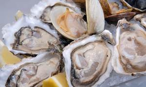 Raw Bar: One Dozen Fresh Oysters with Two Cocktails or Seafood and Steaks for Two at Raw Bar (Up to 50% Off)