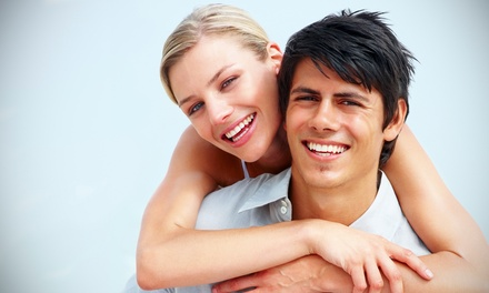 20-Minute or 40-Minute Teeth-Whitening Treatment at Canadian Smile Clinics (Up to 77% Off)