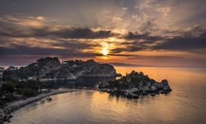Jadera Escursioni: Escursione in barca Isola Bella - Taormina più aperitivo per 2 o 4 persone con Jadera Escursioni (sconto fino a 73%)