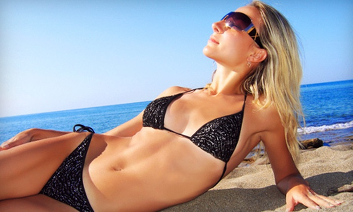 Tropical Resort Tans - Multiple Locations: One Month of Unlimited Level 1–4 Tanning, or Three Mystic Spray-Tanning Sessions at Tropical Resort Tans (Up to 67% Off)