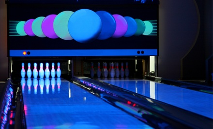 $7 for an All-You-Can-Glow Bowling Package for One with Drink and Hot Dog or Nachos at Country Club Lanes ($14 Value)