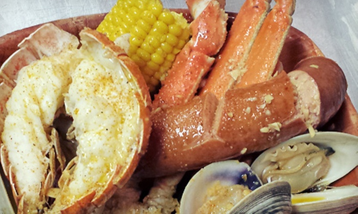 Little New Orleans Kitchen & Oyster Bar - LIttlie New Orleans: Alaskan Dinner with Snow Crab and Sides for Two or Four at Little New Orleans Kitchen & Oyster Bar (58% Off)