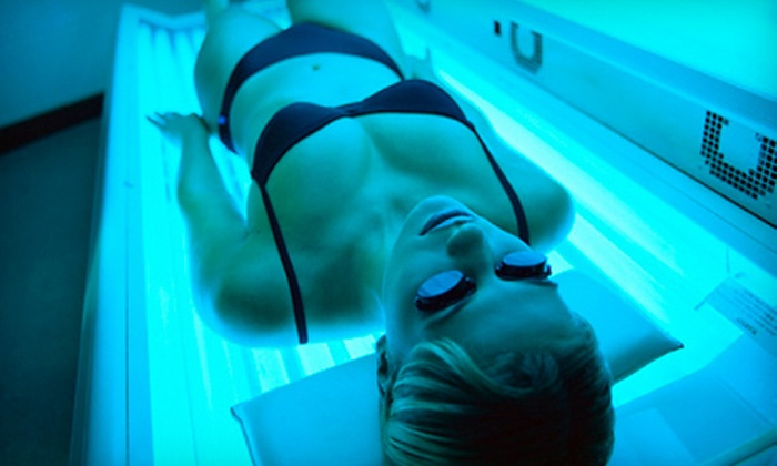 Catchin' Rayz - Multiple Locations: One Month of Unlimited UV Tanning, or Three or Five Mystic Tan Spray Tans at Catchin' Rayz (Up to 72% Off)