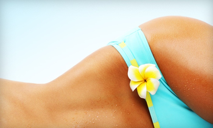 ZipTanz - Multiple Locations: One Month of Unlimited UV or Spray Tanning at ZipTanz (Up to 58% Off). Three Options Available.