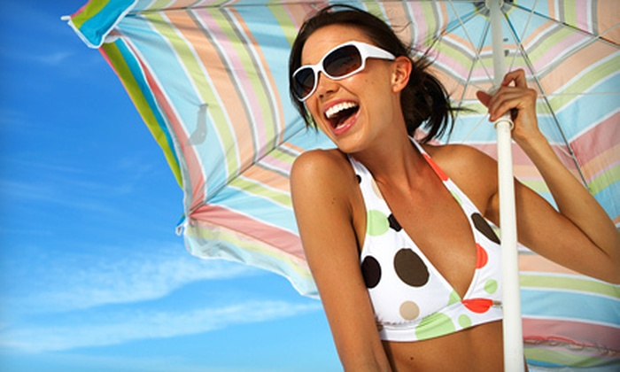 Sizzle Tans - Multiple Locations: Two VersaSpa Spray Tans, One Custom Airbrush Tan, or Seven Days of VIP Tanning at Sizzle Tans (Up to 88% Off)