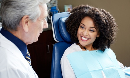 One or Two Dental Checkups or One Whitening Kit at Tomorrow's Dentistry Today (Up to 84% Value)
