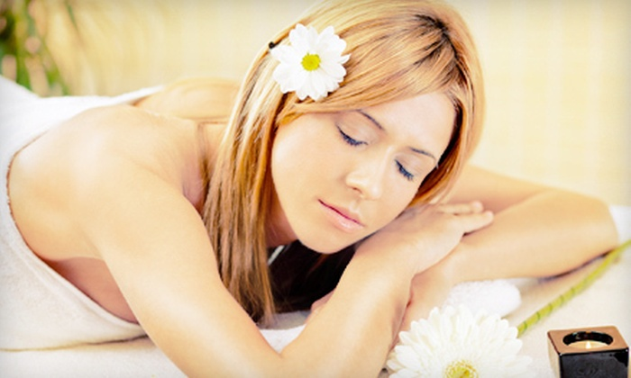 The Woodhouse Day Spa - Doctor Phillips: $175 for a Spa Package with a Massage, Facial, Pedicure, and Eye Treatment at The Woodhouse Day Spa ($355 Value)