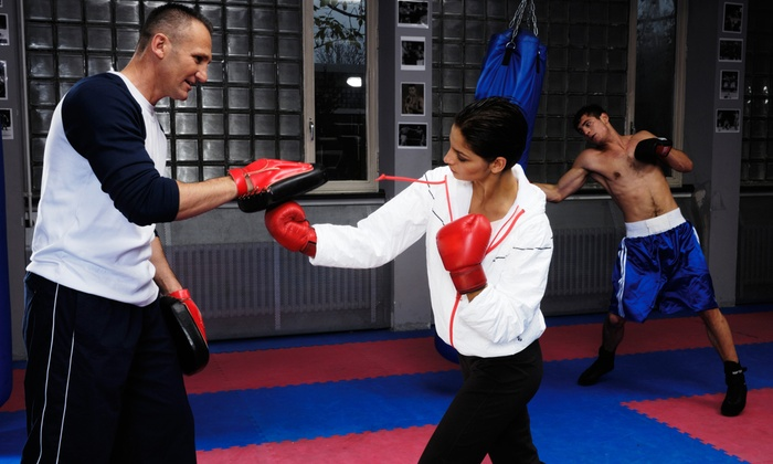 KRU Muay Thai - Tekoa: 6 Muay Thai Kickboxing Classes with T-Shirt or 12 Classes with Shirt and Boxing Gloves at KRU Muay Thai (Up to 58% Off)