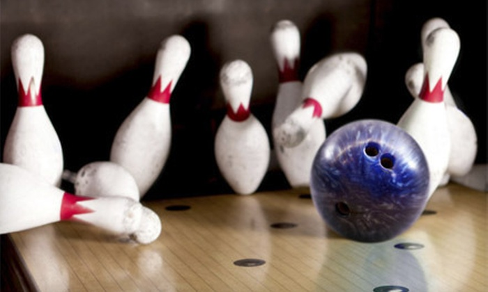 Sunset Lanes - Central Beaverton: $25 for Bowling for Four with Shoes, Large Pizza, and $10 Worth of Arcade Games at Sunset Lanes (Up to $63.79 Value)