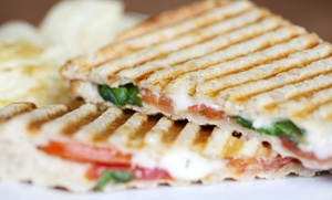 Leche Cafe & Bookstore: $15 for Three Groupons, Each Good for $10 Toward Latin Cafe Fare at Leche Cafe & Bookstore ($30 Value)