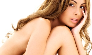 I B Tan Tanning Resort: 5 or 10 Red-Light Therapy Sessions, or One Month of Unlimited Red-Light Therapy Sessions at I B Tan (Up to 67% Off)
