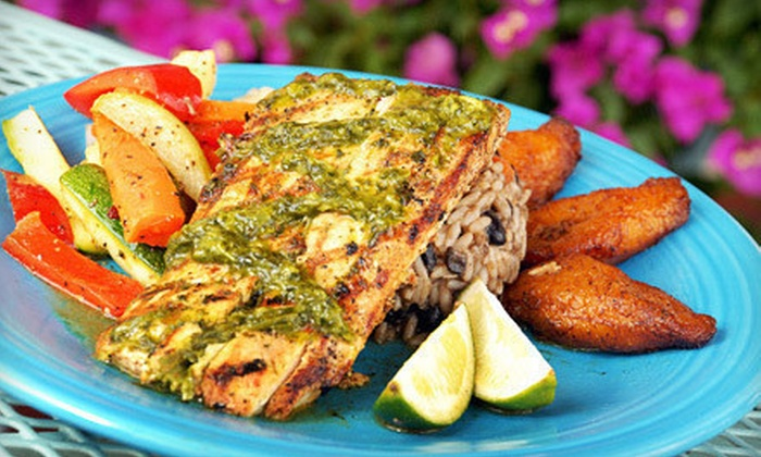 Jerk's Island Grill - 1: Caribbean-Inspired Food and Drinks for Two or Four at Jerk's Island Grill (Half Off)