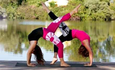 One Month of Unlimited Yoga Classes or a 10-Class Yoga Package at Body Language Fitness and Yoga (Up to  67%Off)
