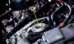 Cosmic Automotive: Oil Change or Wheel Alignment Packages at Cosmic Automotive (Up to 83% Off). Six Options Available.